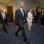 President Barack Obama and House Minority Leader Nancy Pelosi of California leave after meeting with House Democrats on Capitol Hill in Washington on Friday. The president made an 11th-hour appeal to dubious Democrats in a tense run-up to a House showdown on legislation to strengthen Obama's hand in global trade talks.