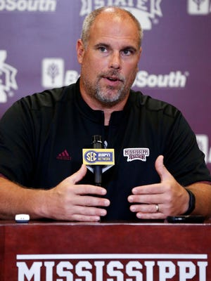 Mississippi State co-offensive coordinator John Hevesy speaks of the team's need to maintain a balanced offensive line this season to reporters during their NCAA college football media day, Monday, Aug. 1, 2016, in Starkville, Miss.