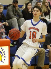 Nate Chorney looks for room to shoot against Waverly