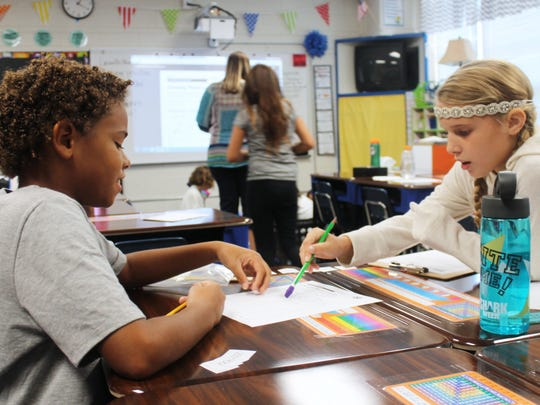 In this 2016 file photo,  Madeline Moore and Artontis Outlaw, students at Buena Vista Elementary School, work together on a math problem.
