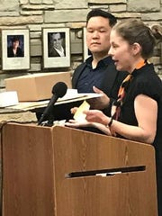 During the July 31 Community Affairs Committee meeting in Wauwatosa, residents Emily and David Kang show another model explaining their concerns over the scale of the proposed apartment building.