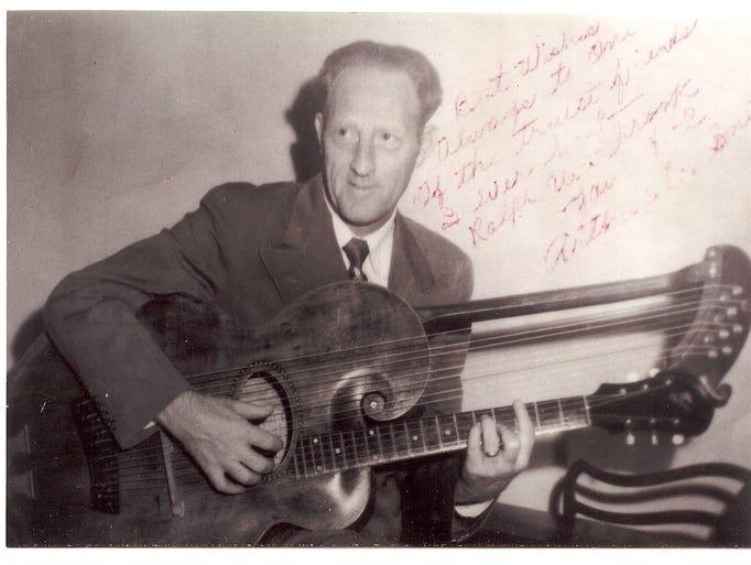 Arthur Q. Smith playing a harp guitar