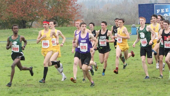 West Salem senior Ahmed Muhumed (left) looks around at other runners at the start of the OSAA Class 6A state cross country meet on Saturday, Nov. 5, 2016.