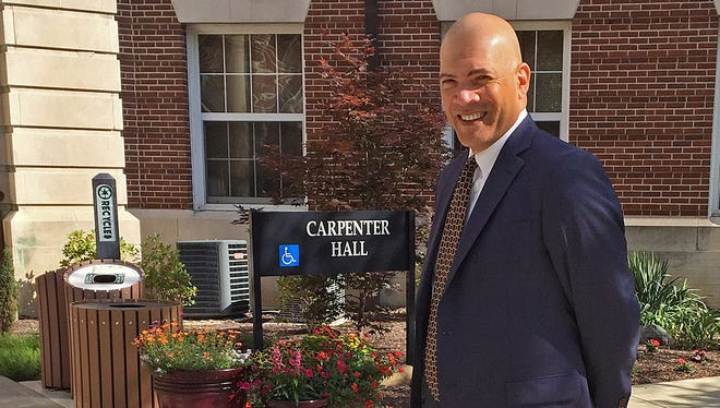 New Earlham College President Alan Price outside of Carpenter Hall on the school's campus.