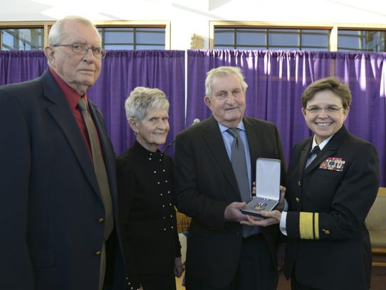 Navy Chief of Chaplains Rear Adm. Margaret Kibben, right, presents a Silver Star Medal to the family of Aloysius Schmitt, who died saving others during the attack on Pearl Harbor. Niece and nephews Dan Schmitt, left, Frances Hemesath, middle, and Del Schmitt are pictured accepting the award on Thursday, Dec. 7, 2017 in Dubuque.