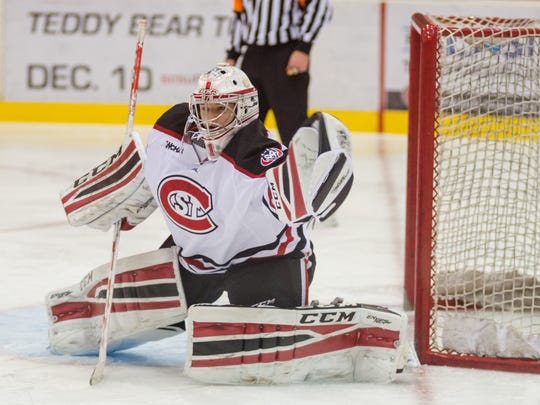 Janine Alder prepares to make a save this season at the Herb Brooks National Hockey Center. Alder, a freshman from Zurich, Switzerland, made 59 saves Saturday in a 2-0 loss at Wisconsin.
