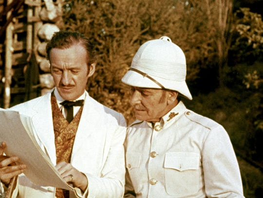 "David Niven starred as Phileas Fogg and Robert Newton as Mr. Fix in the 1956 film adaptation of Jules Verne's ""Around the World in 80 Days."""