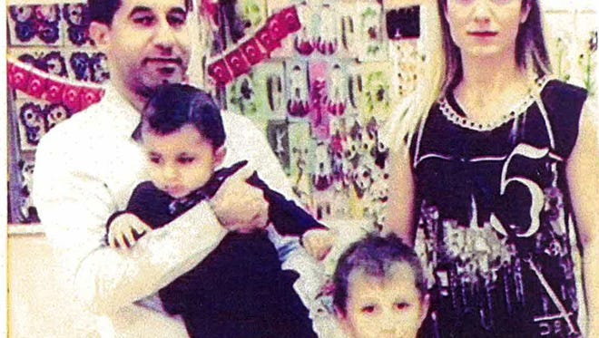 Resit Tavan and wife, Arzu, with sons Kaan Albayrak, now 8, and Resit Yusef Tavan, now 4. The couple also have a teenage daughter.