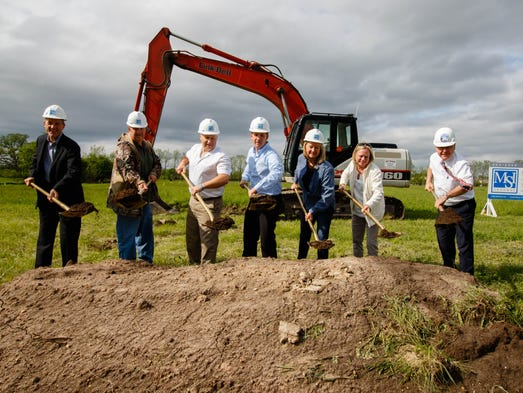 Local dignitaries break ground for the new Summit Village