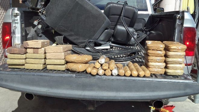 Bundles of heroin, cocaine and methamphetamine confiscated by U.S. Border Patrol agents.