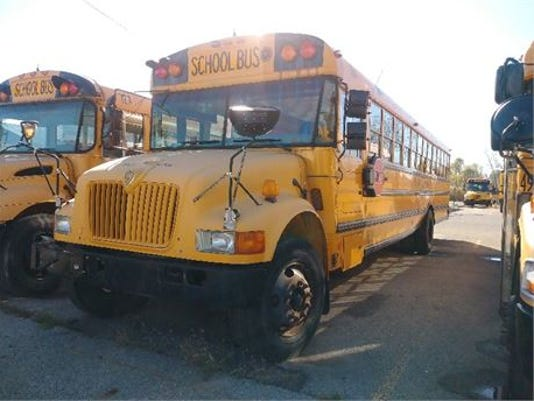 636449594693474436-bus-auction.jpg