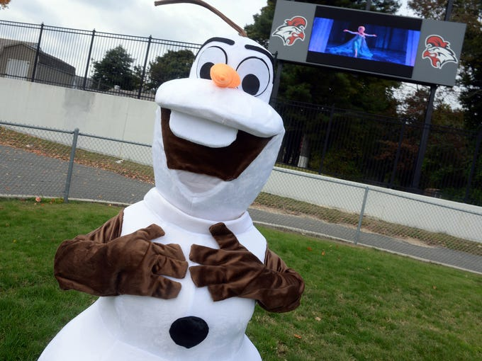 """Costume character Olaf from Disney's """"Frozen"""" stands"""