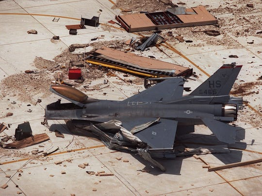 An F-16 sits on the tarmac at Homestead Air Force Base in Homestead, Fla., after Hurricane Andrew destroyed the base on Aug. 24, 1992.