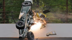 Ed Carpenter hits the wall in the second turn during