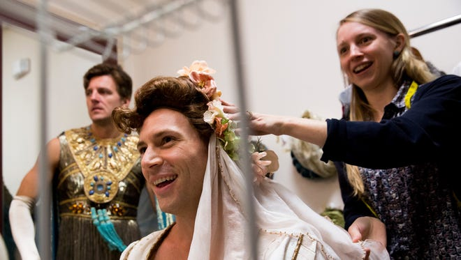 """Zach Martens, one of the male leads of Ken Ludwig's """"Leading Ladies,"""" smiles as he has help from the show's costume designer Lauren Gaston as William Connell, left, the show's other lead, prepares for the show's first tech rehearsal at Gulfshore Playhouse Tuesday, Oct. 31, 2017, in Naples. The show opens Tuesday, Nov. 7."""
