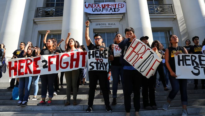 FILE -- Latino students protest Donald Trump on the steps at Sproul Plaza at the campus of the University of California, Berkeley, Oct. 9, 2016. Trump's campaign plan of deporting 2 million to 3 million immigrant criminals raised questions on how he would target for that removal and achieve removals at that scale. (Jim Wilson/The New York Times)