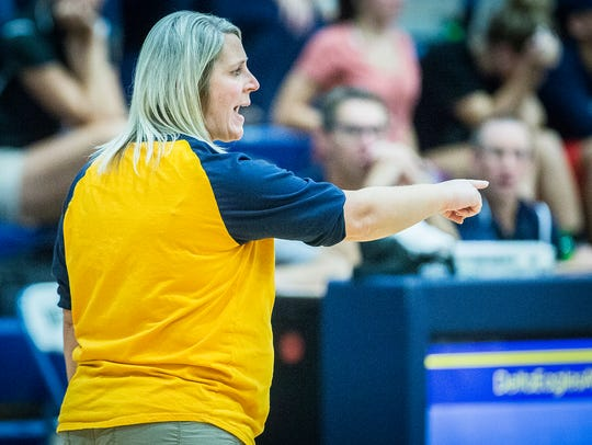 Delta coach Heidi Knuckles gives instructions against