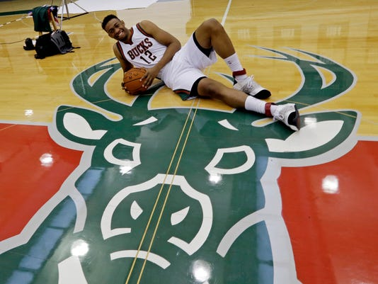 """FILE - In this Sept. 29, 2014 file photo, Milwaukee Bucks' Jabari Parker poses on the Bucks logo during the team's media day in St. Francis, Wis.  A German company that makes a popular liqueur is not raising a shot glass to the Milwaukee Bucks' redesigned logo.  Mast-Jägermeister has filed formal opposition with an appeal board of the U.S. Patent and Trademark Office about the registration of the logo. The company contends it """"has established exclusive rights in the DEER HEAD Marks through use in commerce in the United States"""" going back to 1968. It cites numerous reasons to oppose registration for the NBA team, including the possibility that people might confuse the two companies or believe they are connected or affiliated. (AP Photo/Morry Gash)"""