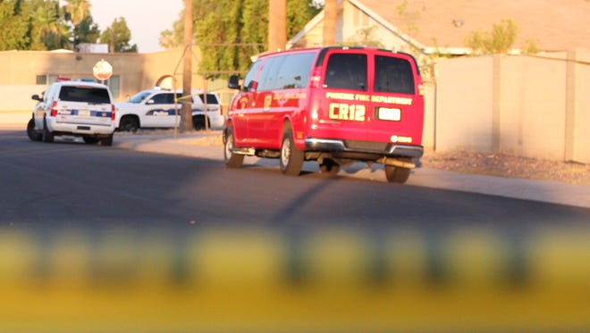 Phoenix police officers were at the scene of a shooting involving an officer on June 29, 2018, near Camelback Road and 43rd Avenue. The city on Thursday agreed to fund a $149,000 study looking into this year's number of officer-involved shootings.