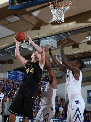 Purdue Boilermakers center Isaac Haas (44) takes a shot against the Kansas State Wildcats during the 2014 EA Sports Maui Invitational at the Lahaina Civic Center. Kansas State defeated Purdue 88-79.