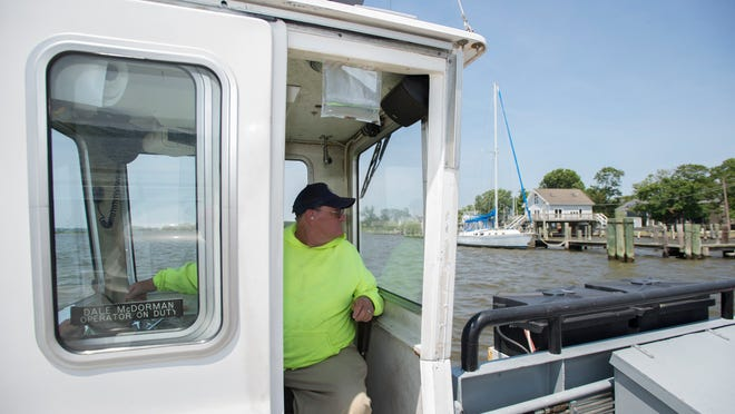 Dale McDorman has been a ferry operator for eight years, taking passengers and their vehicles from one side of the Wicomico River to the other.