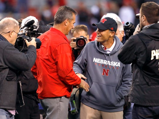 Ohio State coach Urban Meyer shakes hands with Nebraska coach Mike Riley prior to Saturday night's game.