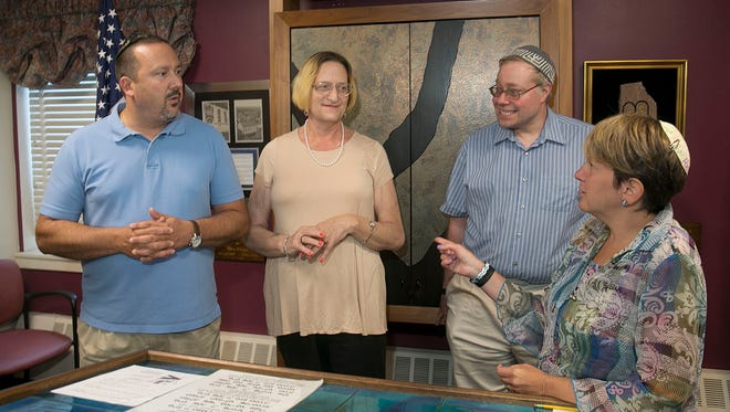 Congregation B'nai Israel, a Conservative Jewish synagogue in Toms River, is starting an outreach aimed at attracting gay, lesbian, bi-sexual and transgender Jews to the synagogue.l-r Philip Brilliant, president, Eva Parpar, Toms River, Hazzan Steven Walvick and Rabbi Ellen Wolintz-Fields—July 21, 2016 -Toms River, NJ.-Staff photographer/Bob Bielk/Gannett NJ