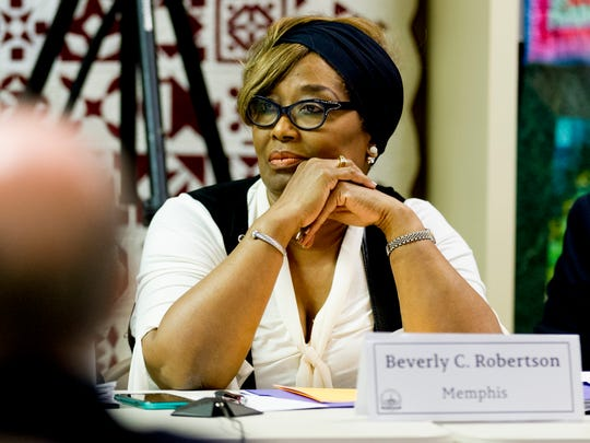 Commission member Beverly Robertson listens during
