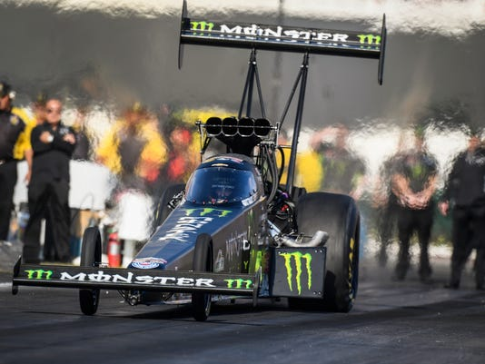 In this photo provided by the NHRA, Brittany Force drives in Top Fuel qualifying Friday, Nov. 10, 2017, at the Auto Club NHRA Finals drag races at Auto Club Raceway in Pomona, Calif. Force took the top spot for the day, with qualifying continuing Saturday. (Jerry Foss/NHRA via AP)