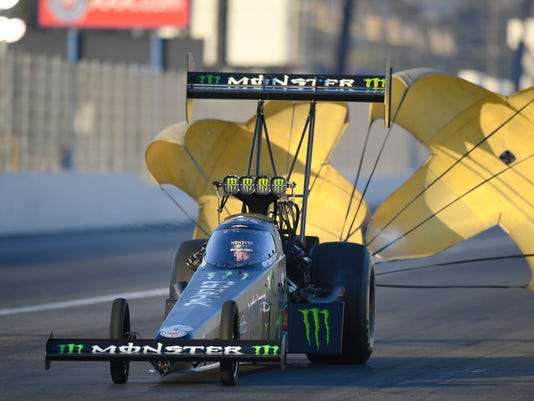 In this photo provided by the NHRA, Brittany Force slows after a run in Top Fuel qualifying at the Auto Club NHRA Finals drag races at Auto Club Raceway, Saturday, Nov. 11, 2017, in Pomona, Calif. Force's qualifying run Friday held up for the No. 1 spot. (Marc Gewertz/NHRA via AP)