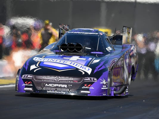 In this photo by NHRA, Jack Beckman makes a run in Funny Car qualifying for the Lucas Oil NHRA Winternationals at Auto Club Raceway on Friday, Feb. 9, 2018, in Pomona, Calif. (Jerry Foss/NHRA via AP)