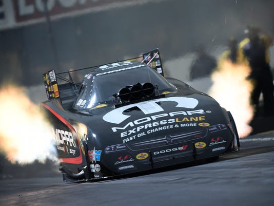 In a photo provided by the NHRA, Matt Hagan drives in Funny Car qualifying at the 58th annual Lucas Oil NHRA Winternationals drag races at Auto Club Raceway on Saturday, Feb. 10, 2018, in Pomona, Calif. Hagan had a run of 3.822 seconds at a track-record 336.32 during his second pass of the day to take the top sport in qualifying. (Marc Gewertz/NHRA via AP)