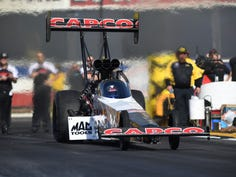 In this photo provided by the NHRA, Robert Hight drives in Funny Car qualifying at the Lucas Oil NHRA Winternationals drag races at Auto Club Raceway on Friday, Feb. 8, 2019, in Pomona, Calif. Hight leads the category with a run of 3.871 seconds at 329.67 mph recorded during his second pass of the day. (Jerry Foss/NHRA via AP)