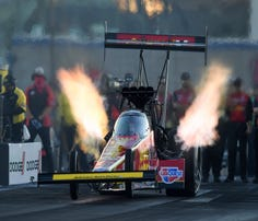 In this photo provided by the NHRA, Brittany Force drives in Top Fuel qualifying Friday, Nov. 1, 2019, at the Dodge NHRA Nationals drag races in Las Vegas. Force had a pass at 3.659 seconds at 338.17 mph. (Marc Gewertz/NHRA via AP)