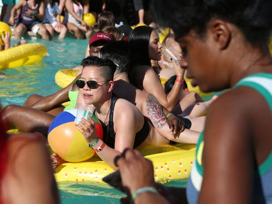 Jae Ng of San Francisco floats on a raft during The Dinah 2015 pool party at the Hilton Palm Springs in Palm Springs on Saturday, April 4, 2015. The Dinah celebrates its 25th anniversary this year.
