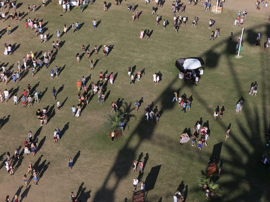 Fans flock to the grounds during the Coachella Music and Arts Festival in Indio on Friday.