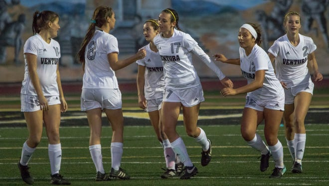 Ventura High striker Peyton Erickson, center, had a hand in all five goals the Cougars scored in the 5-2 win over rival Buena on Jan. 20 at Larrabee Stadium. She scored a hat trick and had two assists.