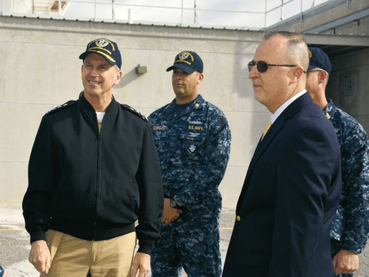 WSMR Executive Director Paul Mann, right, greets Chief of Naval Operations (CNO) Adm. Jonathan Greenert. Greenert was at White Sands Missile Range March 25 to visit the Navy operations.
