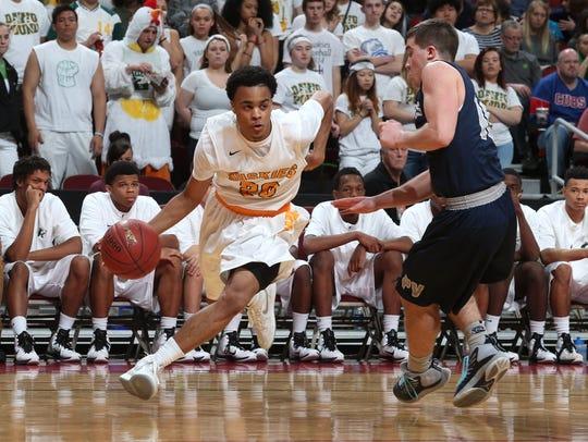 Hoover senior Chris King drives to the basket against