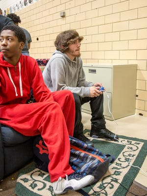 Teenagers at the Boys & Girls Club of Muncie relax and play video games or basketball on Feb. 27. The club has served teenagers in grades 6-12 for the past few years, but will now open at 3:30 p.m. for kids to have a place to do homework and socialize in a safe environment.