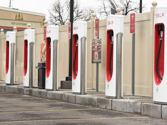 Tesla charging stations are shown at the Clearwater Travel Plaza. There are about 380 charging stations across the state, which, auto dealers say, creates concerns among consumers about not being able to get electric vehicles recharged.