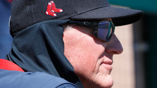 FILE - Boston Red Sox interim manager Ron Roenicke watches from the dugout during a spring training baseball game against the Houston Astros, Thursday, March 5, 2020, in Fort Myers, Fla. Roenicke was told Sunday, Sept. 27, 2020 he will not return as manager of the Red Sox, ending a one-year, shotgun stopgap on the final day of a pandemic-shortened season that resulted in a last-place finish in the AL East.