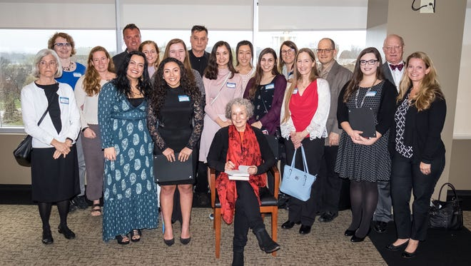 Winners, mentors and parents pose for a photo with Margaret Atwood at last Wednesday's awards ceremony.
