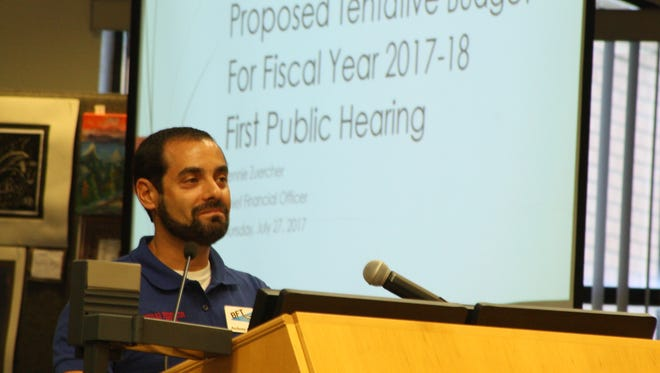 Anthony Colucci, vice president of the Brevard Federation of Teachers union, speaks at the School Board budget hearing on Thursday. He told the board that teacher raises should be their top priority.