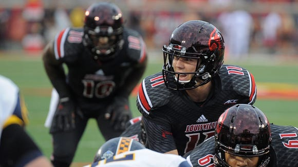UofL quarterback Will Gardner calls a play at the line of scrimmage against Murray State on Saturday at Papa John's Cardinal Stadium. (By David Lee Hartlage, Special to the C-J) Sept. 6, 2014.