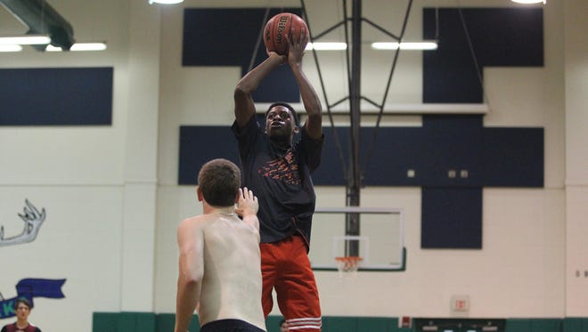 Chiles senior Kamari Brown shoots a short jumper against a teammate during summer practice. Brown is one of three seniors that has never been on a plane yet will travel to New Hampshire on Friday for a summer tournament.
