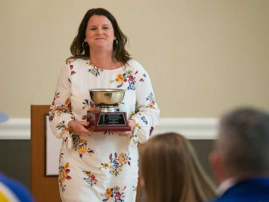 Jodi Hollamon receives the 2017 DSBA Tubby Raymond Award for Excellence in Coaching at the Annual Delaware Sportswriters & Broadcasters Association Banquet recognizing the best in Delaware Athletics.