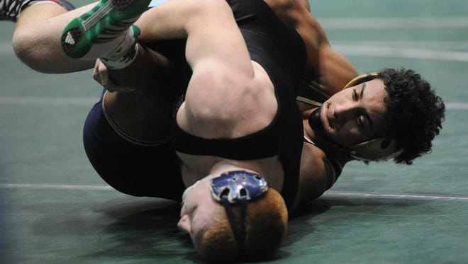 Blake Rypel of Cathedral, right,  won this semifinal match in the 182-pound class, Feb. 15, 2014.