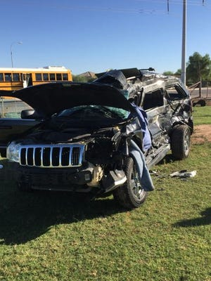 A woman was killed and a 16-year-old boy seriously injured when an SUV collided with a school bus in south Phoenix on Oct. 3, 2016.