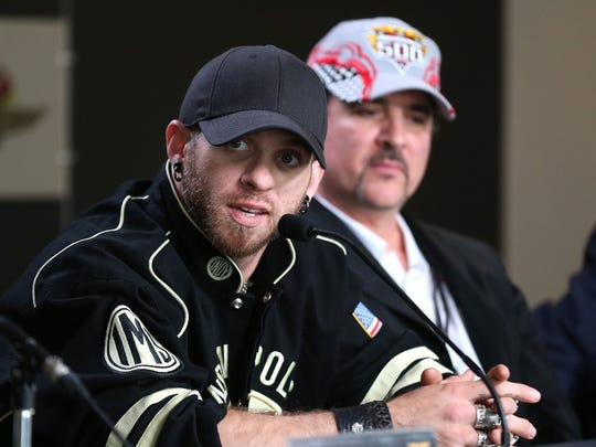 Brantley Gilbert, left, and Big Machine CEO Scott Borchetta meet the press at Indianapolis Motor Speedway in May.